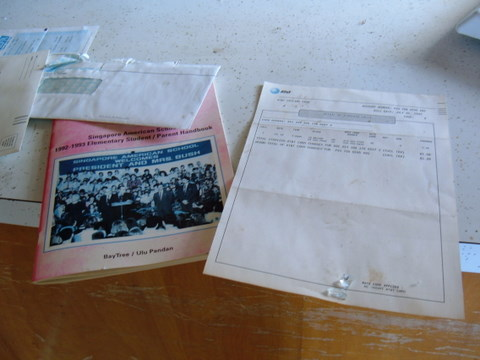 Papers and pamphlets, including an ATT phone bill, from 1993 in an abandoned house on Treasure Island.