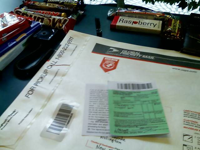 addressed mail envelope and candies