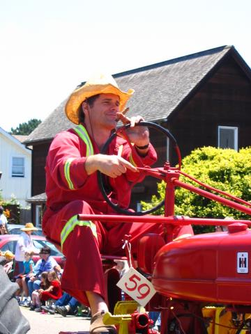 fireman on a tractor smoking a cigar