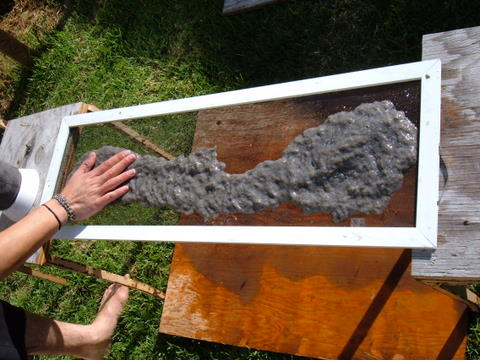 spreading pulp onto a screen for paper making