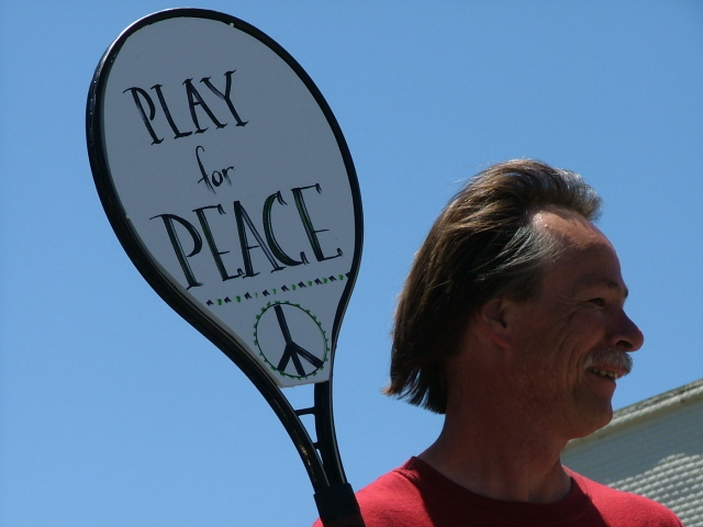man with a tennis racket in the mendocino fourth of july parade