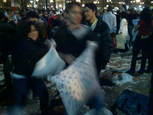 people getting ready to pillow fight